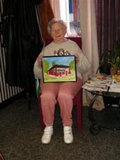 Mary Lou Taylor with her painting of Courtney Road Service Station, Henrico County, Virginia.