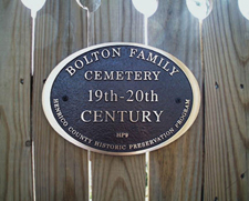 Plaque identifying Bolton family cemetery that was restored by Sylvia Hoehns Wright, a Bolton family member.