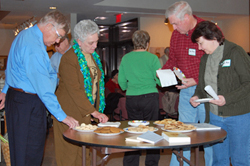 A taste of history:  Members sample refreshments made by the Friends of Meadow Farm according to historic recipes.  Dishes included Jumbles and Mrs. Robert E. Lee's gingerbread.