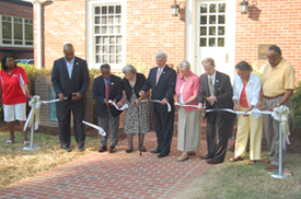 The ribbon is cut to reopen the Museum in Memory of Virginia Randolph.