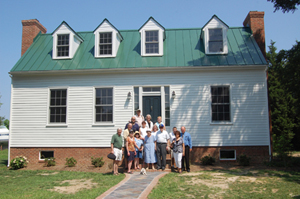 APHA members pose on the steps of the restored Springdale farmhouse.