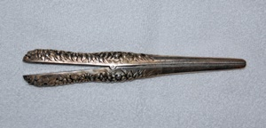 Glove stretcher made of sterling.