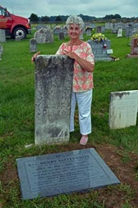 Dot Chewning, standing next to grave of Rev. Henry Satterwhite.